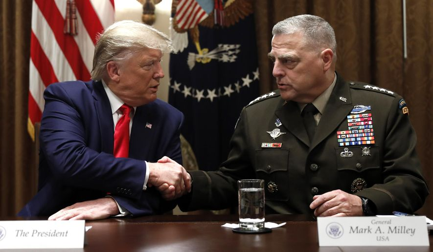 President Donald Trump shakes hands with Chairman of the Joint Chiefs of Staff Gen. Mark Milley during a briefing with senior military leaders in the Cabinet Room at the White House in Washington, Monday, Oct. 7, 2019. (AP Photo/Carolyn Kaster)