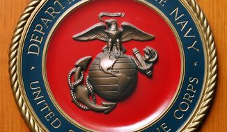 Logo des Marine Corps der Vereinigten Staaten von Amerika aufgenommen am Freitag, 10. Aug. 2007 in der Botschaft der USA in Berlin. (AP Photo/Michael Sohn) --- Logo of the United States Marine Corps pictured at the embassy of the USA in Berlin, Germany, Friday, Aug. 10, 2007. (AP Photo/Michael Sohn)