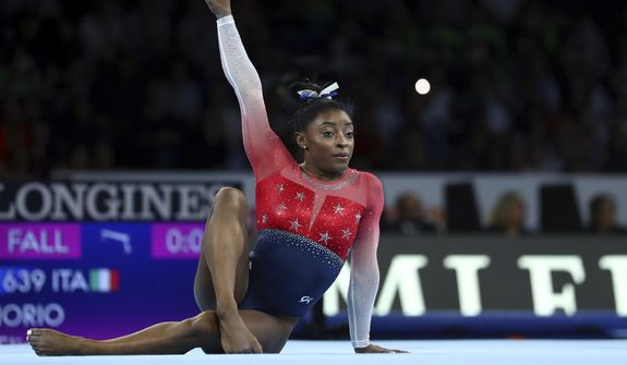 Simone Biles of the U.S. performs on the floor during women's team final at the Gymnastics World Championships in Stuttgart, Germany, Tuesday, Oct. 8, 2019. (AP Photo/Matthias Schrader)