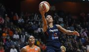 Washington Mystics' Natasha Cloud drives to the basket past Connecticut Sun's Alyssa Thomas, left, and Courtney Williams, right, during the second half in Game 4 of basketball's WNBA Finals, Tuesday, Oct. 8, 2019, in Uncasville, Conn. (AP Photo/Jessica Hill) ** FILE **