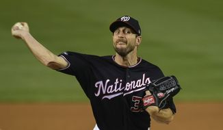 Washington Nationals starting pitcher Max Scherzer (31) throws against the Los Angeles Dodgers during the second inning in Game 4 of a baseball National League Division Series, Monday, Oct. 7, 2019, in Washington. (AP Photo/Susan Walsh)