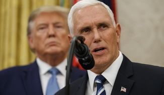 Vice President Mike Pence, right, speaks, with President Donald Trump behind him, during a ceremony to present the Presidential Medal of Freedom to former Attorney General Edwin Meese, in the Oval Office of the White House, Tuesday, Oct. 8, 2019, in Washington. (AP Photo/Alex Brandon)