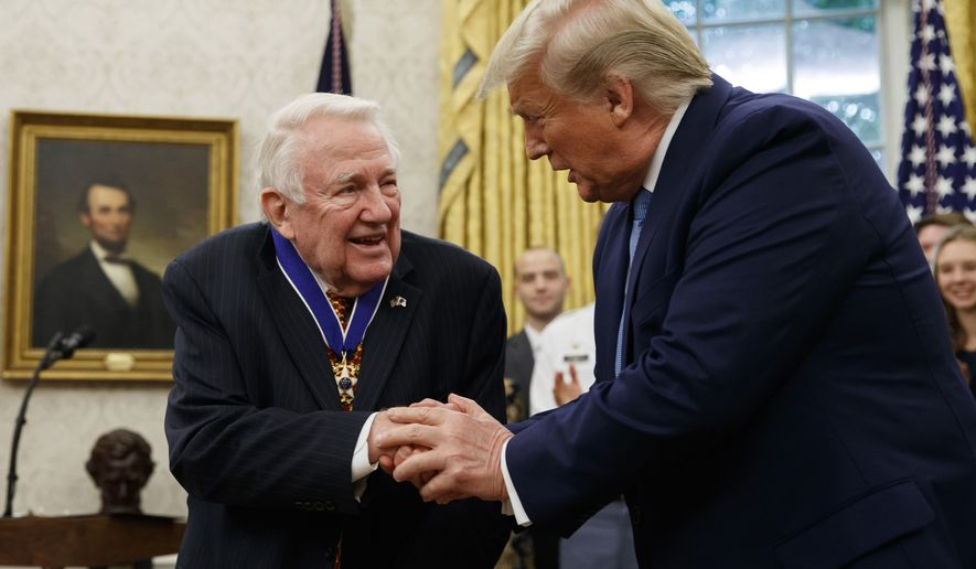 President Donald Trump shakes hands with former Attorney General Edwin Meese after presenting him the Presidential Medal of Freedom, in the Oval Office of the White House, Tuesday, Oct. 8, 2019, in Washington. (AP Photo/Alex Brandon)