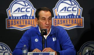 Duke coach Mike Krzyzewski answers a question during the Atlantic Coast Conference NCAA college basketball media day in Charlotte, N.C., Tuesday, Oct. 8, 2019. (AP Photo/Nell Redmond)