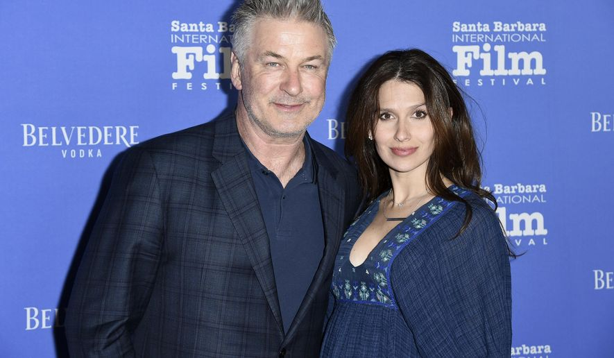 FILE - This Jan. 31, 2018 file photo shows Alec Baldwin, left, and Hilaria Baldwin at the Santa Barbara International Film Festival in Santa Barbara, Calif. Baldwin says he fell for a scam Statue of Liberty tour where he says he bought $40 tickets for a boat tour of the Statue of Liberty for his family but was instead escorted to a shuttle bus to New Jersey. He says his family ultimately ended up taking the Staten island Ferry, which is free and passes the Statue of Liberty. (Photo by Richard Shotwell/Invision/AP, File)