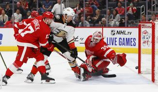 Anaheim Ducks left wing Nick Ritchie (37) scores on Detroit Red Wings goaltender Jimmy Howard (35) as defenseman Filip Hronek (17) defends in the third period of an NHL hockey game, Tuesday, Oct. 8, 2019, in Detroit. (AP Photo/Paul Sancya)