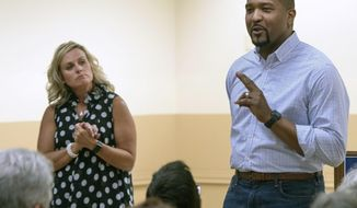 In this Tuesday, July 30, 2019 photo, Democratic State Sen. Eddie Melton, right, and state superintendent of public instruction Jennifer McCormick speak at a town hall in Hammond, Ill. Melton is formally entering the Indiana governor's race on Tuesday, Oct. 8 with McCormick, the state's Republican schools chief, expected by his side. The first-term senator, of Gary, told The (Northwest Indiana) Times that he's joining the 2020 race because most people feel that the Republican-led state government isn't focused on issues like increased education funding and health care access that matter the most.  (Michael Gard/Post-Tribune)/Chicago Tribune via AP)