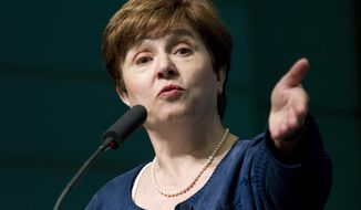 """FILE - In this April 18, 2018, file photo the World Bank CEO Kristalina Georgieva speaks during the forum Frontiers in Anticorruption at the World Bank/IMF annual spring meeting in Washington. Georgieva, the new head of the 189-nation International Monetary Fund, says the world economy is in the grips of a """"synchronized global slowdown"""" that will result in slower growth for 90% of the world this year. (AP Photo/Jose Luis Magana, File)"""