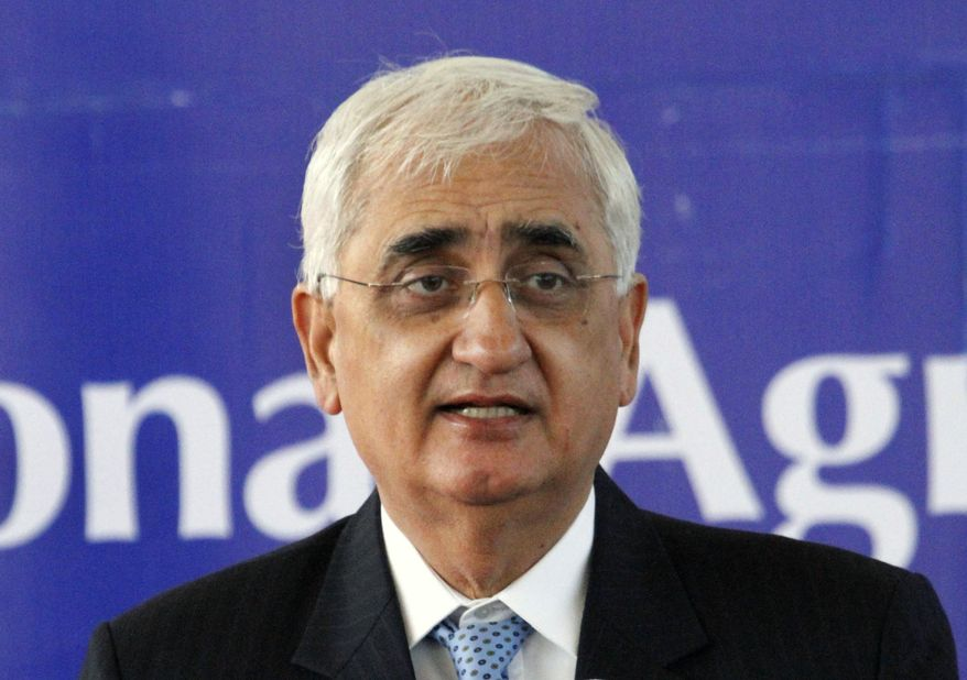 FILE - In this Saturday, Feb. 15, 2014, file photo, Indian Foreign Minister Salman Khurshid speaks at the inauguration ceremony of the Afghan National Agriculture Science and Technology University in Kandahar province south of Kabul, Afghanistan.  The senior leader of India's main opposition Congress party says the party's struggles are to the point where it may not be able to win key upcoming state elections in 2019 or ensure its own future. Khurshid also says the party is facing attrition because it's taking too long to come to terms with its defeat in May, 2019, national elections.  (AP Photo/Allauddin Khan, File)
