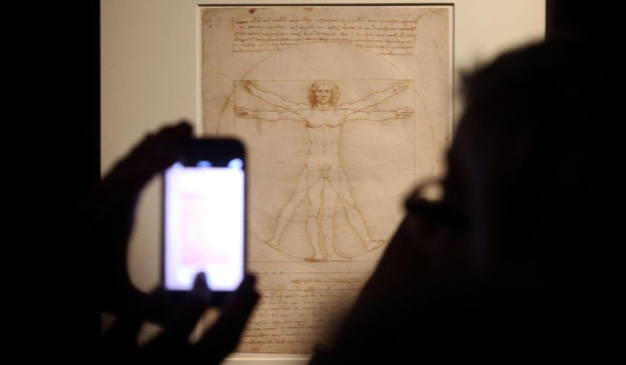 """This Tuesday April 14, 2015 photo made available Tuesday Oct. 8, 2019 shows Leonardo da Vinci's """"Vitruvian Man"""" during an exhibition in Milan, Italy. An administrative court in Venice has temporarily suspended Tuesday Oct. 8, 2019  the loan of Leonardo da Vinci's """"Vitruvian Man"""" to the Louvre for an exhibition that is set to open later this month. (Matteo Bazzi/ANSA via AP)"""