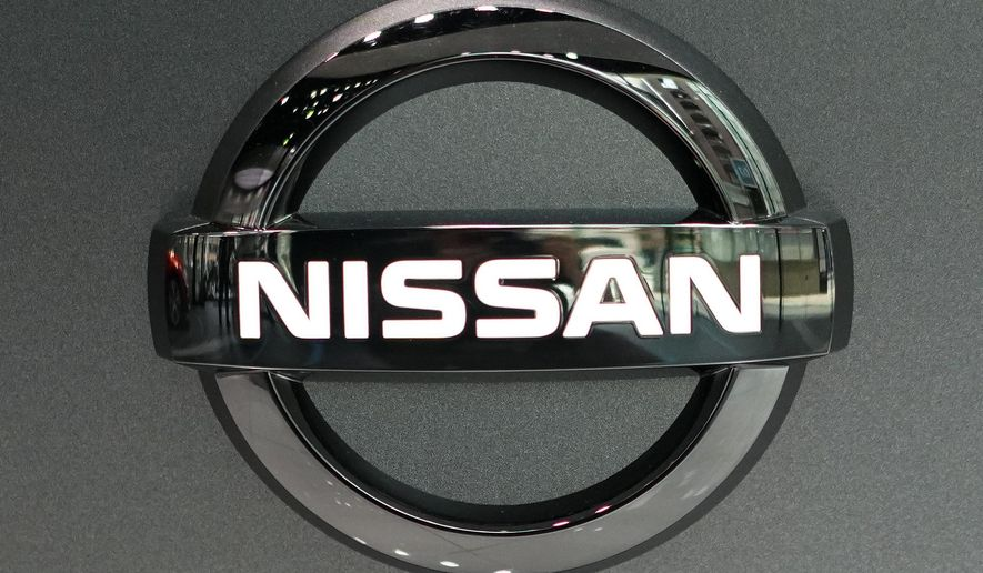 In this July 25, 2019, file, photo, Nissan logo is seen at a Nissan car gallery in Tokyo. Japanese automaker Nissan Motor Co. has named the head of its China business, Makoto Uchida, to be its new CEO.  (AP Photo/Eugene Hoshiko, File)