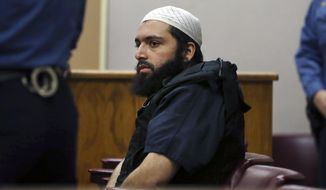 FILE - In this Dec. 20, 2016 file photo, Ahmad Khan Rahimi, the man accused of setting off bombs in New Jersey and New York's Chelsea neighborhood, sits in court in Elizabeth, N.J. Jurors in New Jersey have resumed deliberations on Tuesday, oct. 8,2 019, in the attempted murder trial of Rahimi, who was already convicted of planting bombs in New York City. He's accused of engaging police in a gun battle after they found him sleeping in a doorway. An officer was shot, and Rahimi was riddled with police bullets.  (AP Photo/Mel Evans, File)