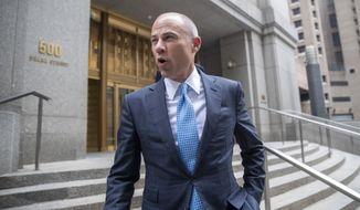Attorney Michael Avenatti leaves Manhattan Federal court, Tuesday, Oct. 8, 2019, in New York. (AP Photo/Mary Altaffer)