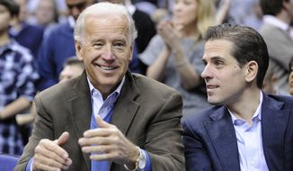 In this Jan. 30, 2010, photo, Vice President Joe Biden, left, with his son Hunter, right, at the Duke Georgetown NCAA college basketball game in Washington. (AP Photo/Nick Wass) ** FILE **