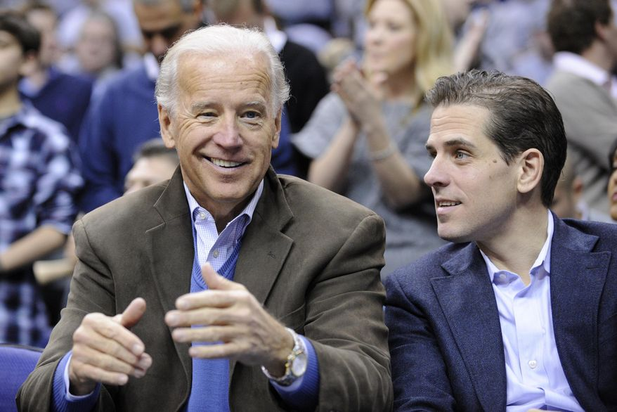 In this Jan. 30, 2010, file photo, Vice President Joe Biden, left, with his son Hunter, right, at the Duke Georgetown NCAA college basketball game in Washington. (AP Photo/Nick Wass, File)