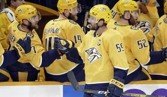 Nashville Predators defenseman Roman Josi (59), of Switzerland, is congratulated after scoring a goal against the San Jose Sharks during the first period of an NHL hockey game Tuesday, Oct. 8, 2019, in Nashville, Tenn. (AP Photo/Mark Humphrey)