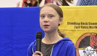Swedish climate activist Greta Thunberg, 16, speaks at Standing Rock High School, Tuesday, Oct. 8, 2019, in Fort Yates, N.D.. Thunberg's visit was part of a panel discussion on American Indian opposition to pipeline projects including the Dakota Access and Keystone XL pipelines. (Tom Stromme/The Bismarck Tribune via AP)