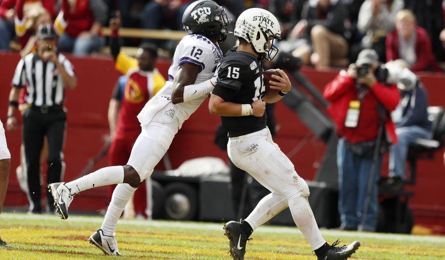 Iowa State quarterback Brock Purdy (15) scores on a 10-yard touchdown run ahead of TCU cornerback Jeff Gladney, left, in the second half of an NCAA college football game, Saturday, Oct. 5, 2019, in Ames, Iowa. Iowa State won 49-24. (AP Photo/Charlie Neibergall)