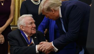 President Donald Trump shakes hands with former Attorney General Edwin Meese after a ceremony to present the Presidential Medal of Freedom to Meese, in the Oval Office of the White House, Tuesday, Oct. 8, 2019, in Washington. (AP Photo/Alex Brandon)
