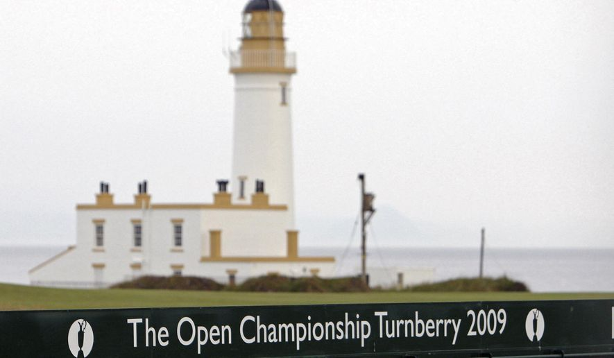 FILE - This July 2, 2009, file photo, shows the Turnberry Lighthouse on the Ailsa Course at the Turnberry golf course in Scotland. President Donald Trump's two golf resorts in Scotland posted losses for the fifth year in a row as the properties contend with a struggling local economy and a backlash against their owner's divisive politics. (AP Photo/Scott Heppell, File)