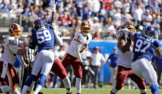 "With Washington 0-5 and going nowhere, the Redskins need to reconsider its definition of ""ready"" regarding rookie quarterback Dwayne Haskins. (Associated Press)"