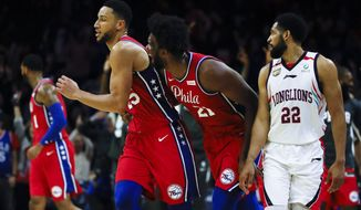 Philadelphia 76ers' Joel Embiid, center right, celebrates with Ben Simmons, center left, after he shot a 3-pointer to end the second quarter as Guangzhou Loong-Lions' CJ Harris, right, looks on during the first half of an NBA exhibition basketball game Tuesday, Oct. 8, 2019, in Philadelphia. (AP Photo/Matt Rourke)