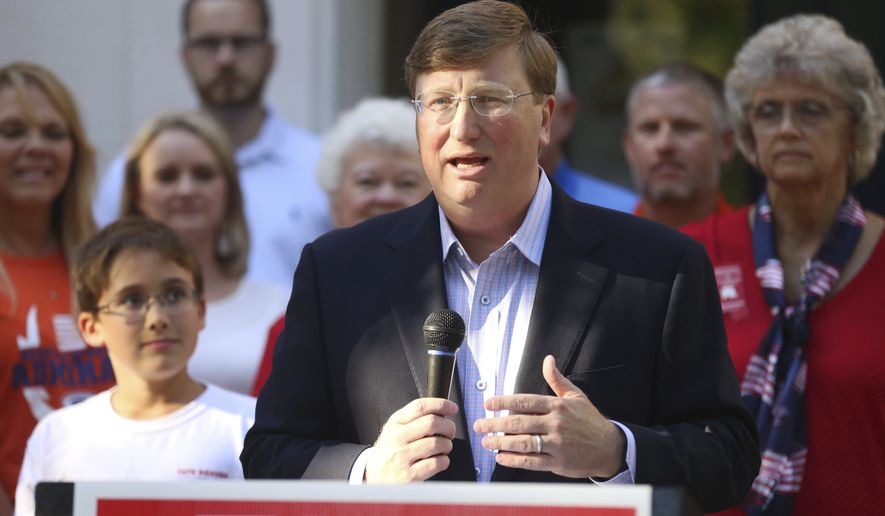 Republican Lt. Gov. Tate Reeves stands in front of a group of current teachers, former educators and students in Gulfport, Miss., Wednesday, Oct. 9, 2019, to lay out his plan to increase public school teachers pay. Reeves faces Democratic Attorney General Jim Hood in their televised gubernatorial debate in Hattiesburg, Thursday evening. (Alyssa K. Newton/The Sun Herald)