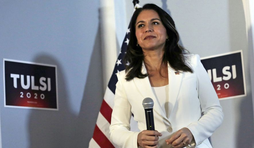 In this Oct. 1, 2019, photo, Democratic presidential candidate U.S. Rep. Tulsi Gabbard, D-Hawaii, listens to a question during a campaign stop in Londonderry, N.H. While Gabbard is campaigning for her party's presidential nomination, she faces a strong primary challenge back home for her congressional seat from Democratic state Sen. Kai Kahele. (AP Photo/Charles Krupa) ** FILE **