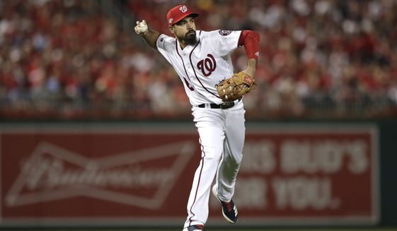 Washington Nationals third baseman Anthony Rendon throws out Los Angeles Dodgers' Max Muncy at first base during the third inning of Game 3 of a baseball National League Division Series Sunday, Oct. 6, 2019, in Washington. (AP Photo/Julio Cortez)