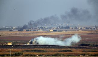 In this photo taken from the Turkish side of the border between Turkey and Syria, in Akcakale, Sanliurfa province, southeastern Turkey, smoke billows from targets inside Syria during bombardment by Turkish forces Wednesday, Oct. 9, 2019. Turkey launched a military operation Wednesday against Kurdish fighters in northeastern Syria after U.S. forces pulled back from the area, with a series of airstrikes hitting a town on Syria's northern border.(AP Photo/Lefteris Pitarakis)