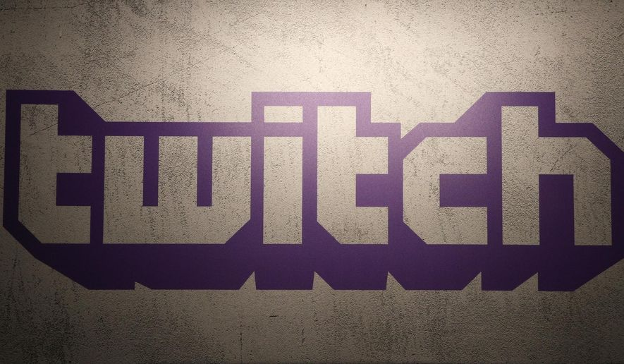 FILE - This Saturday, Nov. 4, 2017, file photo shows the logo of live streaming video platform Twitch at the Paris games week in Paris. The attacker who killed two people in a shooting at a German synagogue live-streamed his assault on Twitch, a video service owned by Amazon. It was one of the first violent attacks streamed on Twitch, which is best known for letting people watch others play competitive video games. (AP Photo/Christophe Ena, File)