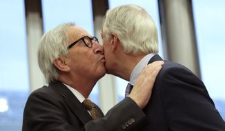 European Commission President Jean-Claude Juncker, left, greets European Union chief Brexit negotiator Michel Barnier prior to the start of the weekly meeting of the College of Commissioners at EU headquarters in Brussels, Wednesday, Oct. 9, 2019. (AP Photo/Virginia Mayo)