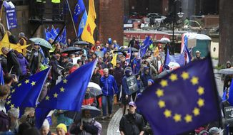 Anti Brexit protesters demonstrate through the streets as part of the Reject Brexit-Defend Our Democracy protest, in Manchester, England, Sunday Sept. 29, 2019. The ruling Conservative Party is committed to Britain's Brexit split from the European Union to leave on the scheduled date of Oct. 31, as they hold the annual party conference in Manchester. (Peter Byrne/PA via AP)