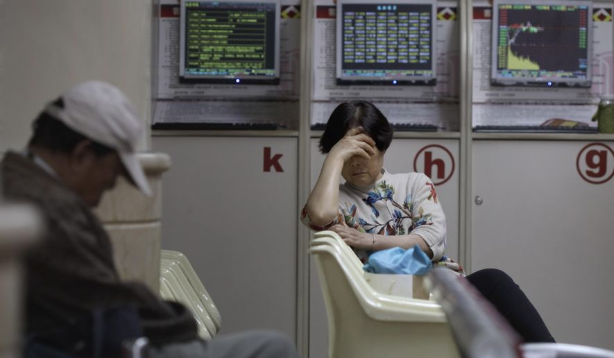 Investors rest at a brokerage in Beijing on Wednesday, Oct. 9, 2019. Shares slipped in Asia on Wednesday as tensions between the U.S. and China flared ahead of talks aimed at resolving the trade war between the world's two biggest economies. (AP Photo/Ng Han Guan)