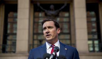 Attorney General for the Eastern District of Virginia G. Zachary Terwilliger announces the arrest of Henry Kyle Frese, a Defense Intelligence Agency official charged with leaking classified information to two journalists, including one he was dating, during a news conference outside the federal courthouse in Alexandria, Va., Wednesday, Oct. 9, 2019. (AP Photo/Andrew Harnik)