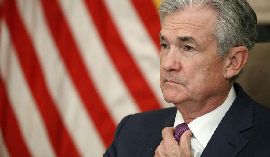 FILE - In this Oct. 4, 2019, file photo Federal Reserve Chairman Jerome Powell attends a panel at the Federal Reserve Board Building in Washington. On Wednesday, Oct. 9, the Federal Reserve releases minutes from its September meeting when it cut interest rates for a second time this year. (AP Photo/Jacquelyn Martin, File)