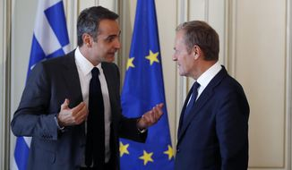 "Greece's Prime Minister Kyriakos Mitsotakis, left, speaks with the European Council President Donald Tusk during their meeting at Maximos Mansion in Athens, Wednesday, Oct. 9, 2019. EU leaders have demanded more ""realism"" from Britain in response to a Brexit plan proposed by British Prime Minister Boris Johnson. (AP Photo/Thanassis Stavrakis)"