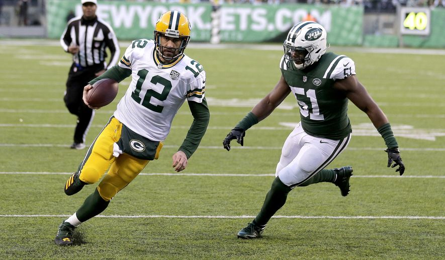 FILE - In this Dec. 23, 2018, file photo, Green Bay Packers quarterback Aaron Rodgers runs for a touchdown as New York Jets outside linebacker Brandon Copeland (51) chases him during the second half of an NFL football game in East Rutherford, N.J. Copeland is suing a company that sold a supplement he says was contaminated with a banned substance that didn't appear on the product's label.Copeland practiced Wednesday, Oct. 9, 2019, for the first time this season after being suspended by the NFL for the first four regular-season games for violating the league's policy on performance-enhancing drugs. Copeland says he failed the test on April 15, and the NFL announced his suspension on Aug. 21. (AP Photo/Seth Wenig, File)