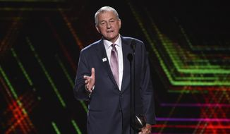 In this July 10, 2019 file photo, Jim Calhoun, men's basketball coach for the University of Saint Joseph in West Hartford, Conn., accepts the best coach award at the ESPY Awards at the Microsoft Theater in Los Angeles.  Calhoun has been accused of sexual discrimination by a former associate athletic director at the University of Saint Joseph, the Division III school where he now works. Jaclyn Piscitelli filed a lawsuit Wednesday, Oct. 9 in U.S. District Court against the school, which began admitting men in 2018.  (Photo by Chris Pizzello/Invision/AP, File)  **FILE**