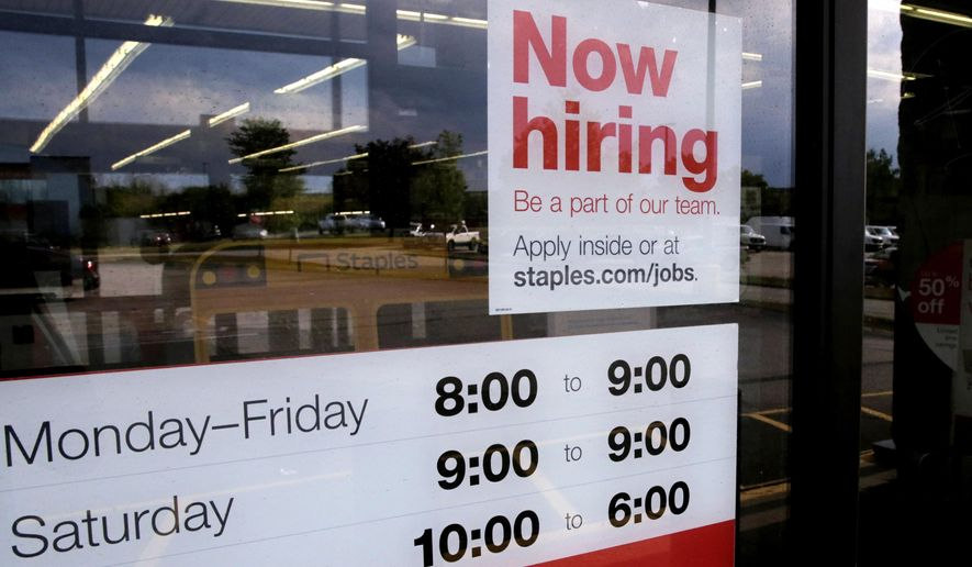 """FILE - In this Aug. 15, 2019, file photo a """"Now hiring"""" sign is displayed on the front door of a Staples store in Manchester, N.H. On Wednesday, Oct. 9, the Labor Department reports on job openings and labor turnover for August. (AP Photo/Charles Krupa, File)"""