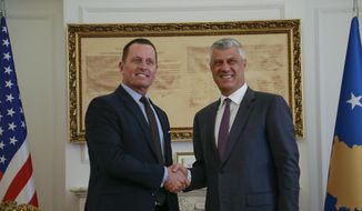 Kosovo's president Hashim Thaci, right, shakes hands with President Donald Trump's envoy for the Kosovo-Serbia dialogue, Ambassador Richard Grenell in Kosovo capital Pristina on Wednesday, Oct. 9, 2019. (AP Photo/Visar Kryeziu)
