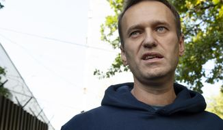 FILE - In this Friday, Aug. 23, 2019 file photo, Russian opposition leader Alexei Navalny speaks to the media as he leaves a detention center after his release, in Moscow, Russia. Russian officials have designated the nonprofit organization behind major anti-corruption investigations as a foreign agent in a move that is likely to hinder their activities. The organization is founded by opposition leader Alexei Navalny. (AP Photo/Dmitry Serebryakov, File)