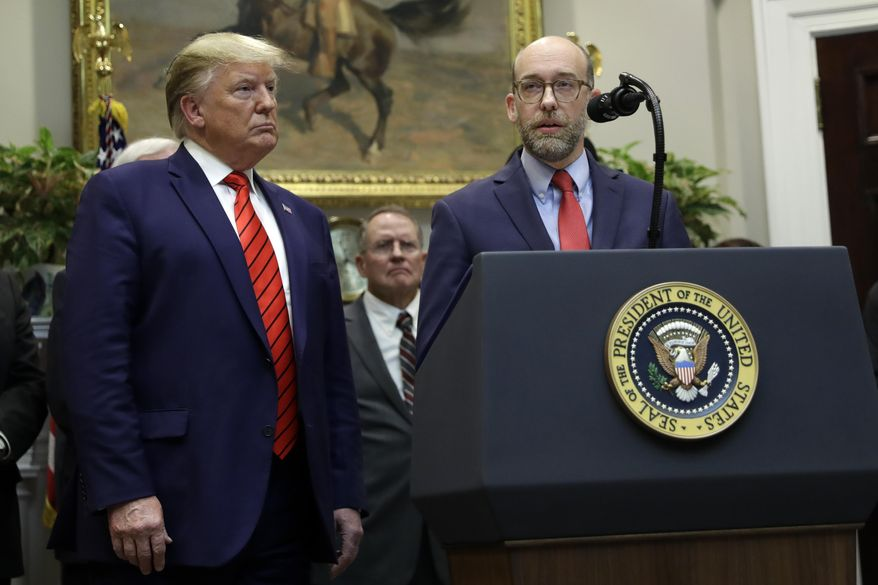 "President Donald Trump listens as acting director of the Office of Management and Budget Russ Vought speaks during an event on ""transparency in Federal guidance and enforcement"" in the Roosevelt Room of the White House, Wednesday, Oct. 9, 2019, in Washington. (AP Photo/Evan Vucci)"