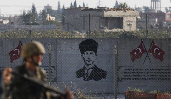 . (AP Photo/Lefteris Pitarakis)