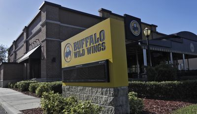 A Buffalo Wild Wings restaurant is shown Tuesday, Nov. 28, 2017, in Valrico, Fla. Fast food chain Arby's is buying Buffalo Wild Wings. The deal is expected to close in 2018's first quarter. It still needs the approval of Buffalo Wild Wings shareholders. (AP Photo/Chris O'Meara)