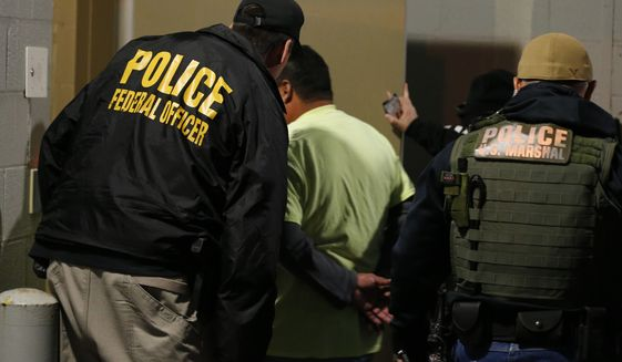 U.S. Immigration and Customs Enforcement in 2019 flagged more than 11,000 illegal immigrants in Los Angeles County Sheriff's Office custody. They accounted for 180 homicide charges, 750 sex crimes and 1,400 weapons offenses. (Associated Press/File)