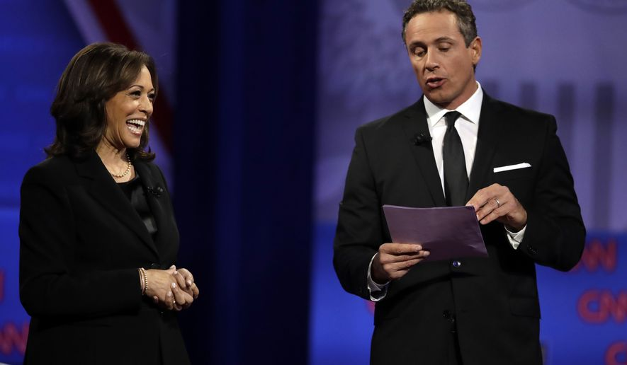 Democratic presidential candidate Sen. Kamala Harris, D-Calif., laughs as CNN moderator Chris Cuomo speaks during the Power of our Pride Town Hall Thursday, Oct. 10, 2019, in Los Angeles. The LGBTQ-focused town hall featured nine 2020 Democratic presidential candidates. (AP Photo/Marcio Jose Sanchez)