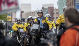 Minneapolis police horse patrol makes their way through Trump supporters waiting to get into the Target Center Thursday, Oct. 10, 2019 in Minneapolis. Anti-Trump protesters are converging on the Minneapolis arena where President Donald Trump is holding his first political rally since the House opened its impeachment inquiry.(Elizabeth Flores/Star Tribune via AP)