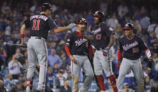 Washington Nationals' Howie Kendrick (47) celebrates after a grand slam against the Los Angeles Dodgers during the 10th inning in Game 5 of a baseball National League Division Series on Wednesday, Oct. 9, 2019, in Los Angeles. (AP Photo/Mark J. Terrill)  **FILE**