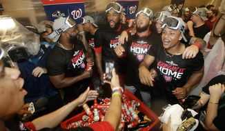 Washington Nationals celebrate in the locker room after their 7-3 win in 10 innings against the Los Angeles Dodgers in Game 5 of a baseball National League Division Series on Wednesday, Oct. 9, 2019, in Los Angeles. (AP Photo/Marcio Jose Sanchez) ** FILE **